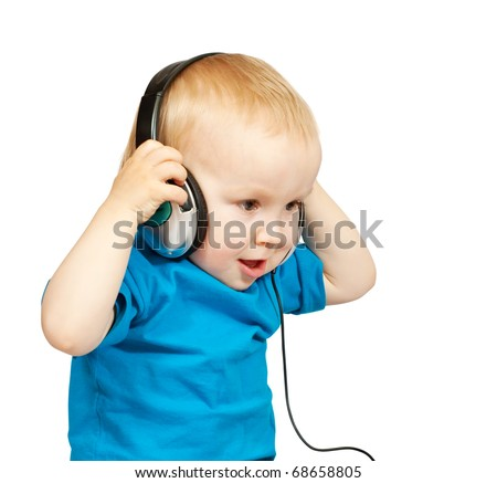 Little  boy listening to music with peaceful expression on face - stock photo