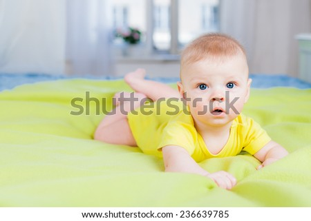 Little boy looking at camera - stock photo