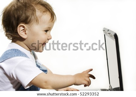 Little Boy looking at Laptop screen on white .