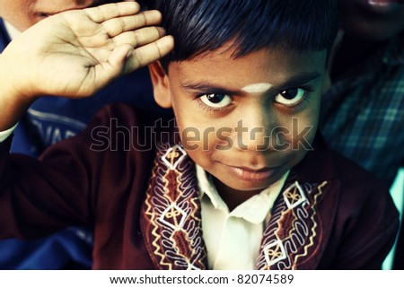 Little boy looking at the camera. - stock photo