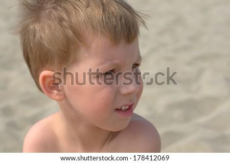 little boy looking forward - stock photo