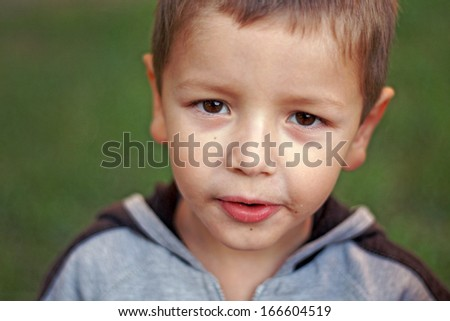 Little boy looking seriously - stock photo
