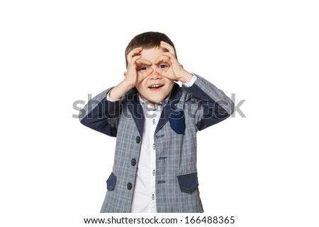 Little boy looking through binoculars hands - stock photo