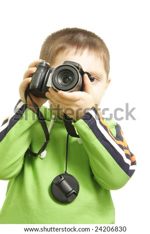Little boy looking through viewfinder photo over white