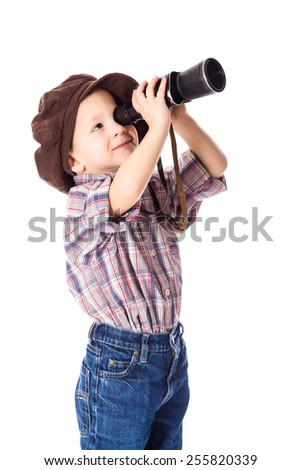 Little boy looking to spyglass, isolated on white - stock photo