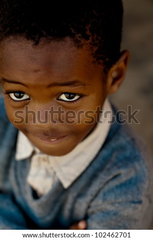Little boy looking up into the camera - stock photo