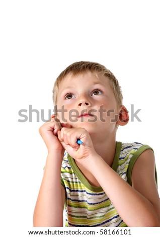 Little boy looking upwards - stock photo