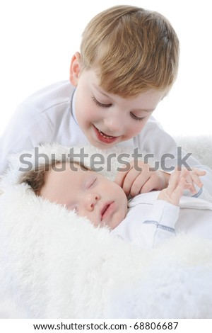 little boy looks at the sleeping brother. Isolated on white background