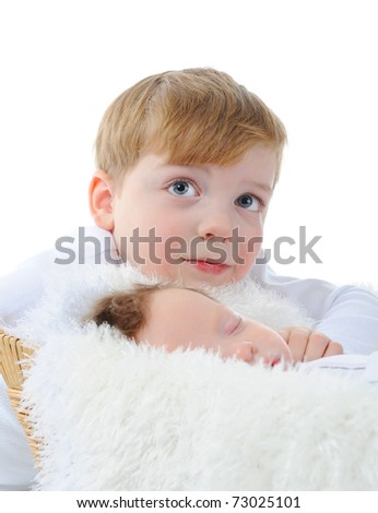 little boy looks at the sleeping brother. Isolated on white background - stock photo