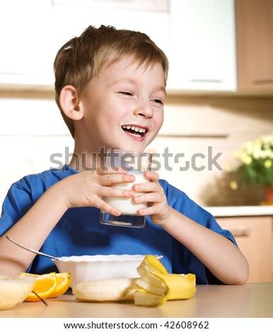 Little boy loves milk - stock photo
