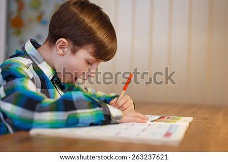 Little boy make mistake in workbook , homework - stock photo