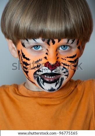 Little boy making face painting. Halloween - stock photo