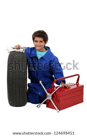 Little boy mechanic on white background - stock photo