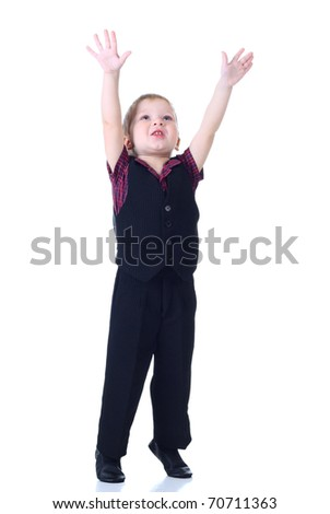 Little boy move hands up at white background - stock photo