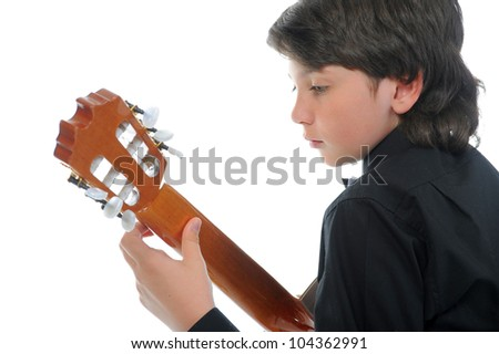 Little boy musician playing on acoustic guitar. Isolated on a white background - stock photo