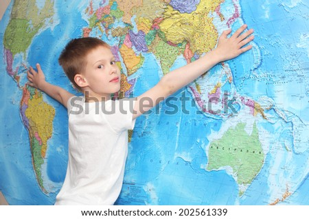 little boy near the wall map