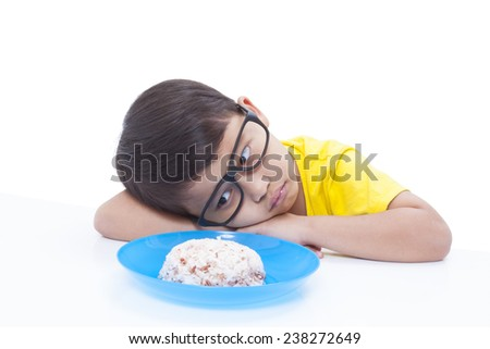 Little boy not wanting to eat  - stock photo