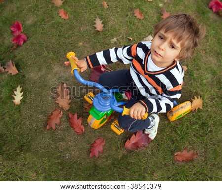 Little boy on a bicycle. Farewell to summer. - stock photo