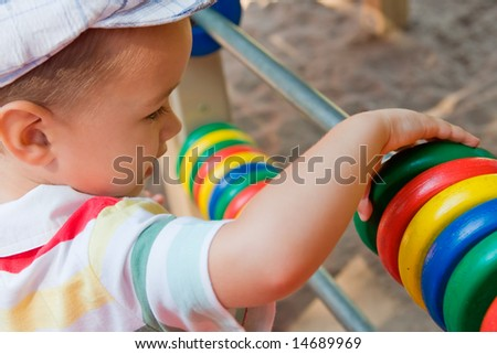 Little Boy on a playground - stock photo