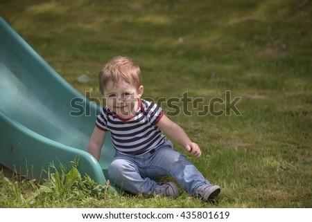 Little boy on a slide - stock photo