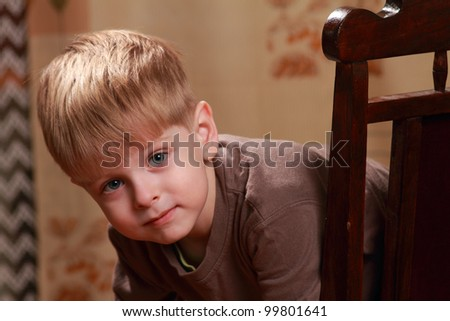 little boy on an antique chair