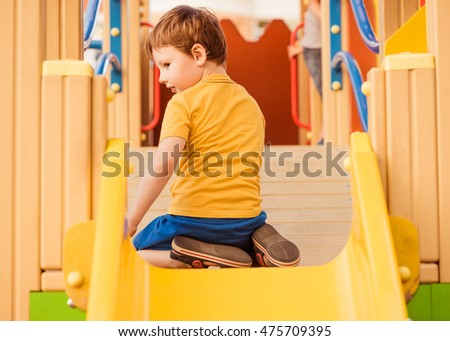 little boy on colorful playground