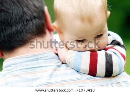 little boy on dad's shoulder