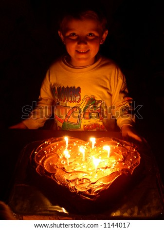 little boy on his birthday with his cake