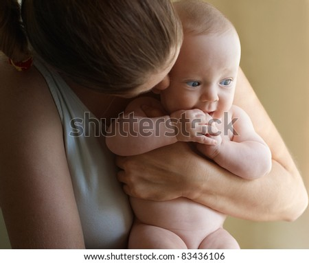 Little boy on mother hands listening her whisper - stock photo