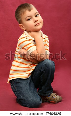Little boy on red background