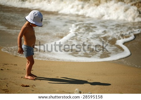 little boy on the beach - stock photo
