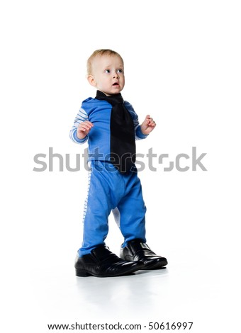 Little boy on the big shoes. Isolated on white - stock photo