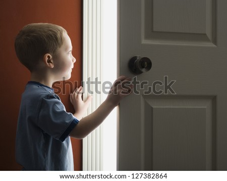 Little boy opening the door at home & Little Boy Opening Door Home Stock Photo (Royalty Free) 127382864 ...