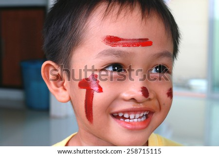 Little boy paint on face - stock photo