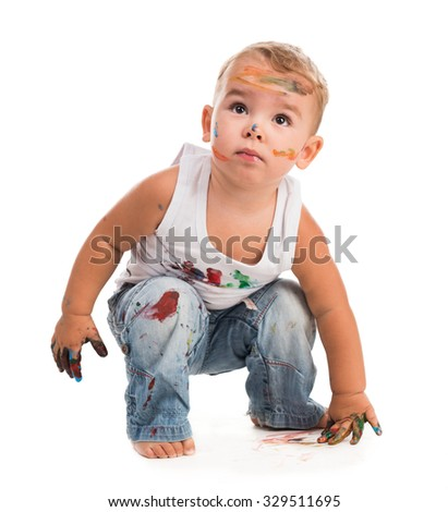 little boy painted with colors isolated on white background - stock photo