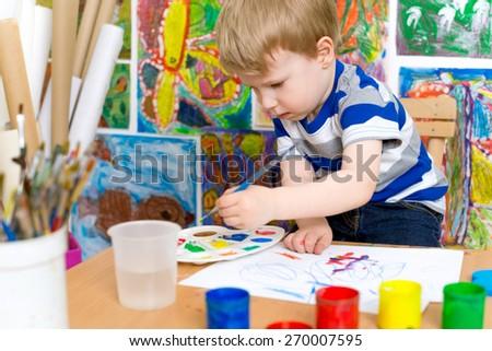 Little Boy Painting - stock photo