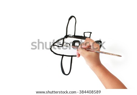 Little boy painting aircraft.  - stock photo