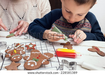 Little boy painting gingerbread man - stock photo