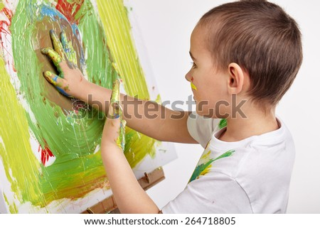 Little boy paints a picture - stock photo