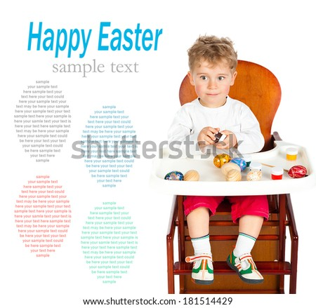little boy paints Easter eggs isolated on white with sample text - stock photo
