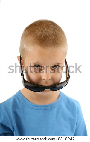 Little boy peeking out over sunglasses