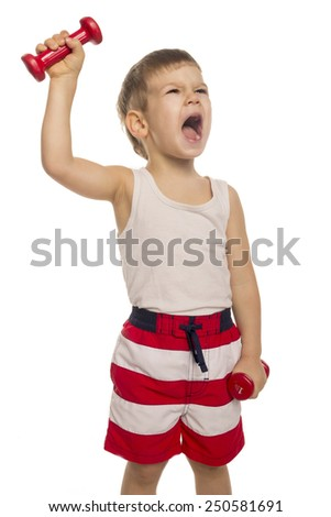 little boy picks up a dumbbell on a white background