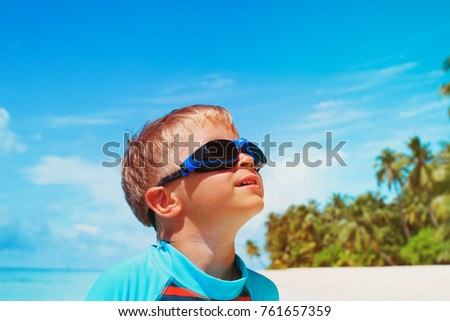 little boy play have fun on tropical beach