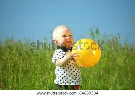 little boy play in green grass - stock photo