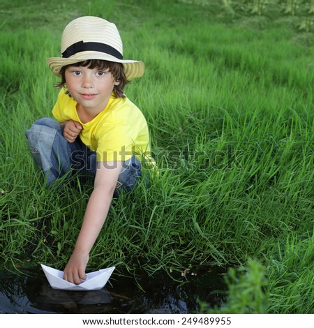 little boy play in water - stock photo