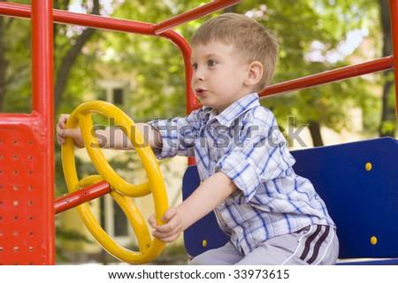 little boy play on playground - stock photo
