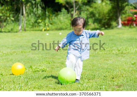 Little boy play soccer - stock photo