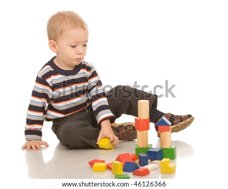 little boy play with bricks - stock photo