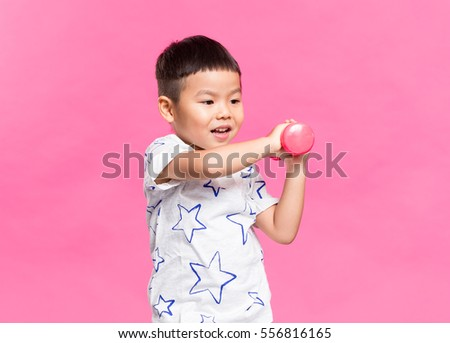 Little boy play with dumbbell