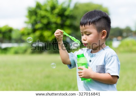 Little boy play with the bubble soap - stock photo